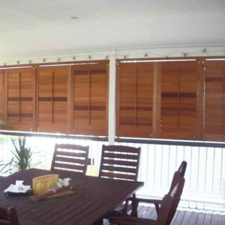 Andrea's Folding Veranda Shutters are a neat way to open the veranda to the world on warm days when the sun is not low enough in the sky to penetrate the living area. Andrea used a tracking system to install these gorgeous shutters. Using a tracking system to install your Western Red Cedar shutters, allows a smooth running action when used in an ideal bifold situation such as this.