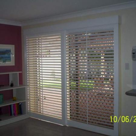 Living Room Painted Shutters.