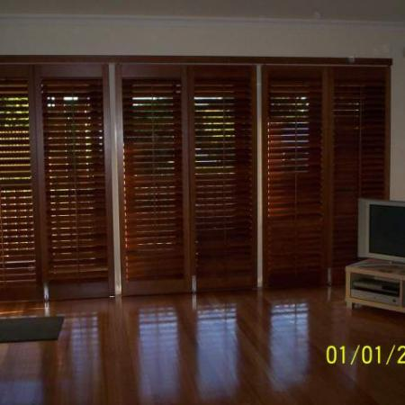 Living room shutters made out of Cedar give a warm and rich feeling to the room. Western Red Cedar can soften the feeling of any room in any house. Sliding Bi-fold Western Red Cedar shutters are designed so you have control of the light and air flow in your home; perfect for brightening up the room or making the perfect home theatre.