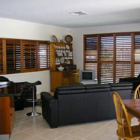 No matter what shape the window ShutterKits can create a cosy backdrop to any situation. Julie and Roy's house is totally fitted out with Western Red Cedar Plantation Shutters. Internal Plantation Shutters have been fitted into the windows in the lounge room creating a lovely feature complimenting the decor and creating a safe cosy feeling in the room.