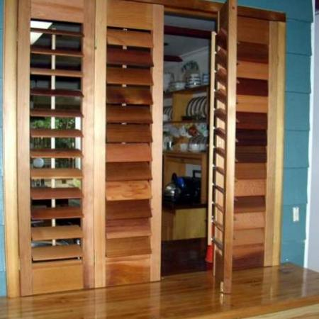 Rod's shutters are practical as well as beautiful. His Western Red Cedar Shutters are oiled and hinged to create easy access from the kitchen. The oil stain enhances the natural features of the timber thus creating stunning feature, fixing the