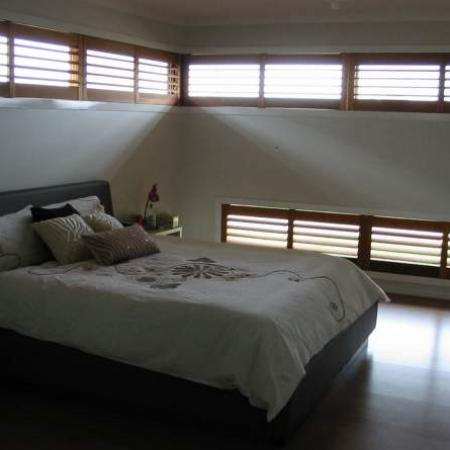 Lisa has a number of windows that are long and skinny; without Plantation shutters they would be difficult to block the sunlight.Plantation shutters assembled as double shutters were an ideal solution for this type of window. Shutterkits can find the solution for any oddly shaped window.