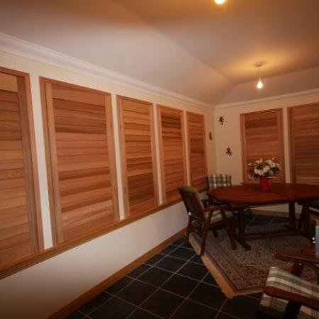 Western Red Cedar Shutters are made of rich natural oiled Cedar; it warms the room, keeps out the cold in winter and shields the room from the sun in summer. These shutters offer the ultimate in privacy and leave you with a cozy safe feeling.