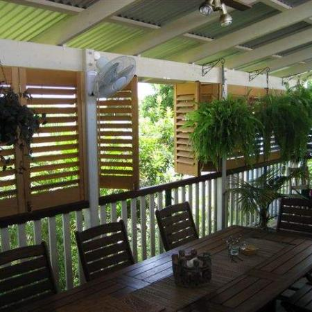 The Western Redd Cedar Plantation Shutters enclose Jakko's classic Queensland veranda. They all bi-fold back so that Jakko can open up the area entirely. Jakko has testified,
