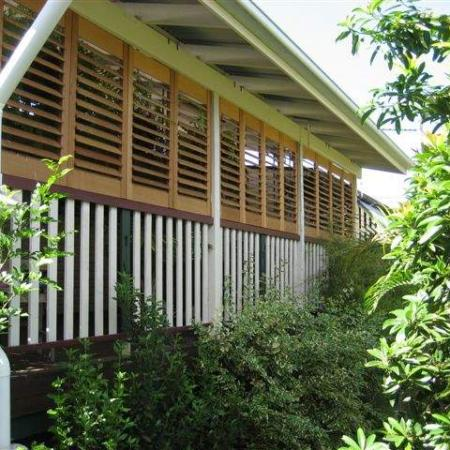 The Western Redd Cedar Plantation Shutters enclose Jakko's classic Queensland veranda, bringing a privacy from the neighbours. They all bi-fold back so that Jakko can open up the area entirely. Jakko has testified,